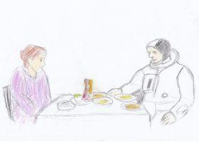 クスクスの食卓を囲むマダム・ハミダとNASAの宇宙飛行士ジョン・マッケンジー。