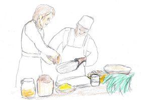 """キクユ族の""""天才料理少年""""カマンテ(右)は、フォークでメレンゲを泡立てる"""