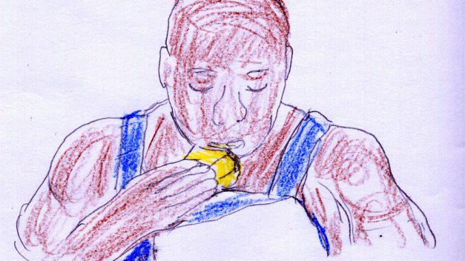 コーンブレッドを食べるジョン